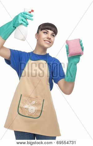 Cleaning Concept: Caucasian Woman Spraying Liquid Cleaner Over The Sponge And Smiling. Isolated Over