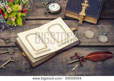 Old Photo Album And Bouquet Of Orchid Flowers
