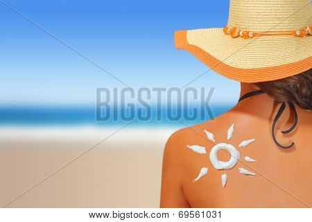 Woman with sun shaped sunscreen on her back