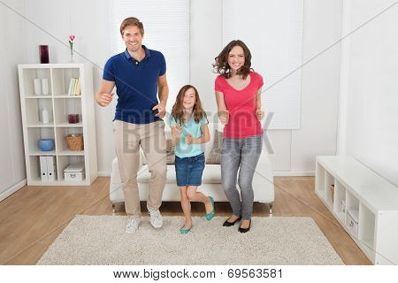 Happy Family Pretending To Run