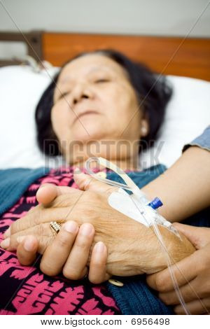 Family Holding Hands In Sickness