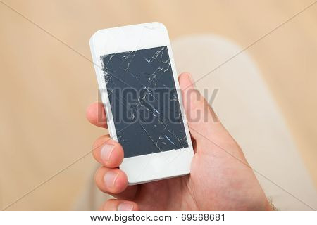 Hand Holding Smartphone With Broken Screen