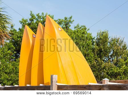 Prows Or Front Of Three Plastic Kayaks Or Canoes