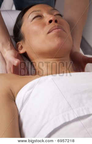 Woman Getting Massage On Neck