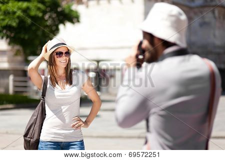 Couple of turists taking picture in the city