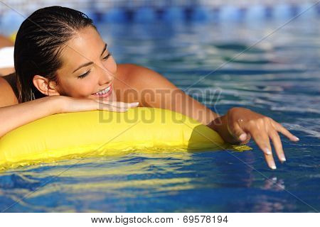 Woman Bathing And Playing With Water On A Swimming Pool In Vacations