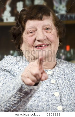 Senior Woman Pointing To You