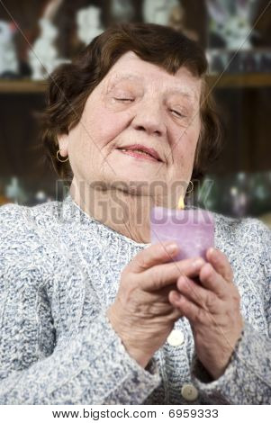 Older Woman With Candle Light