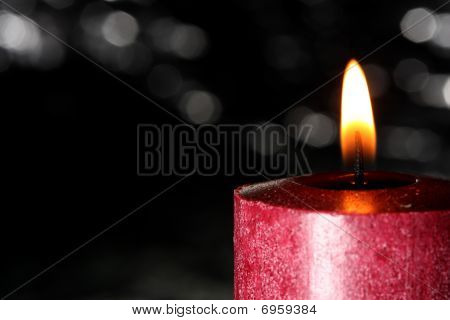 Red Candle Against Black