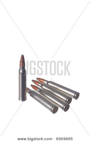 Five rifle cartridges isolated on white background