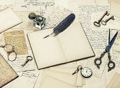 foto of inkwells  - open diary book antique accessories old letters inkwell and vintage feather ink pen - JPG
