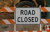 picture of road construction  - Road closed sign in front of construction - JPG