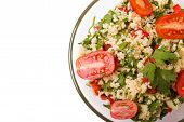 image of tabouleh  - Tabbouleh with couscous and parsley healthy salad in glass bowl on white background up view - JPG