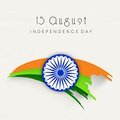 stock photo of indian independence day  - Stylish Asoka Wheel on national tricolors wave on beige background for 15th of August - JPG