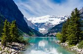 picture of hamlet  - Beautiful Lake Louise with Victoria Glacier in the background and a glistening emerald lake - JPG