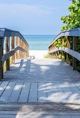 picture of gulf mexico  - Wooden boardwalk to ocean amond sea oats on Sunset Beach at southern tip of Treasure Island Florida on Gulf of Mexico - JPG