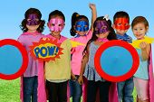 Постер, плакат: Group of children who are dressed up as superheroes