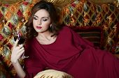 pic of night gown  - Sensual woman with a red wine glass on a magnificent sofa - JPG