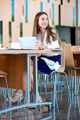 image of canteen  - Girl studying with ipad in the University canteen - JPG