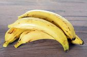 picture of plantain  - sweet ripe plantain bananas on rustic table - JPG