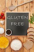 picture of wheat-free  - Gluten free handwritten on a chalk board surrounded by ingrediients - JPG
