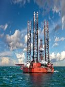 picture of big-rig  - Oil rig at sea against the amazing blue sky - JPG