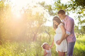 pic of maternity  - Happy pregnant family having fun in summer nature  - JPG