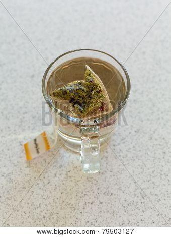 Chamomile Teabag In Glass Mug On Table