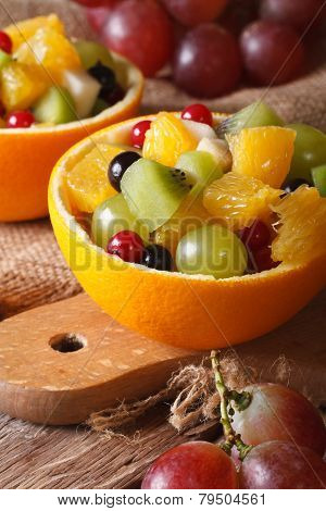 Oranges Stuffed With Fresh Fruit Salad Close-up Vertical