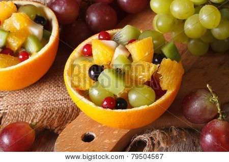 Oranges Stuffed With Fresh Fruit Close-up Horizontal Top View