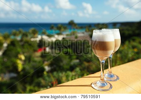 spanish coffee latte in tall glasses with morning sunny light background