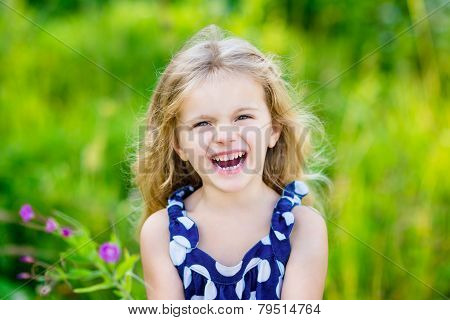Fanny And Beautiful Laughing Little Girl With Long Blond Curly Hair, Outdoor Portrait In Summer Park