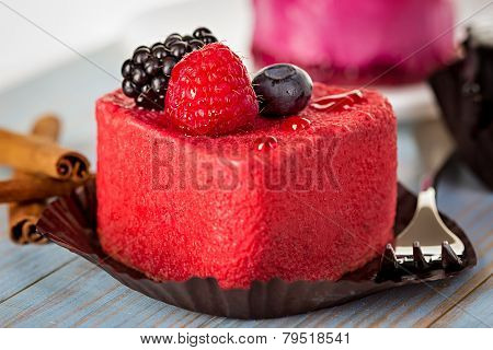 Pink Cake With Berries On Wooden Background