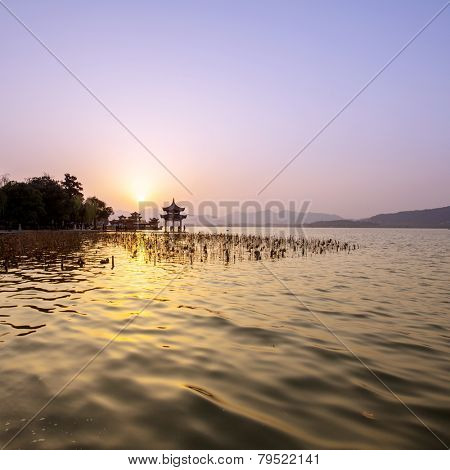 skyline and lake at sunset in hangzhou,china