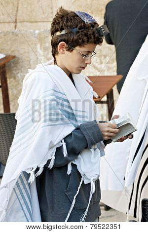 JERUSALEM, ISRAEL - OCTOBER 31, 2014:  An unidentified Jewish boy worshiping at the Western Wall.