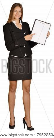 Business woman showing forefinger on clipboard.