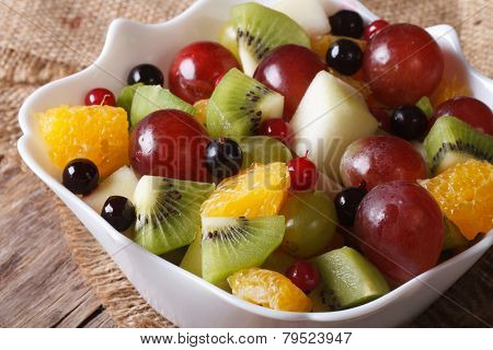 Salad Of Oranges, Kiwi, Grapes And Berries Macro. Horizontal