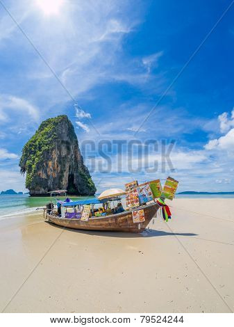 KRABI, Thailand - NOVEMBER 3, 2014: Food and drinks seller on boat at Phranang beach in Krabi, Thailand on NOVEMBER 3, 2014