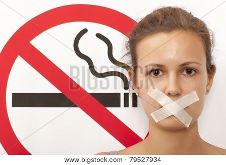Woman. No smoking concept a no smoking sign