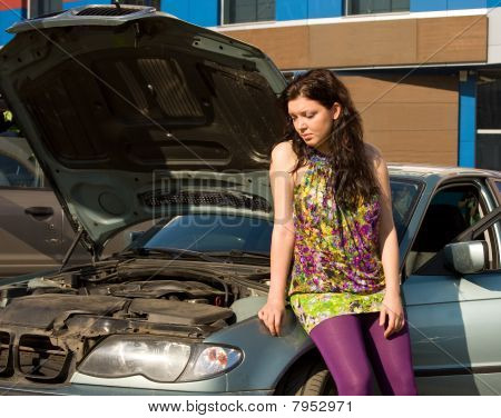 Young Blond Woman With Her Broken Car.