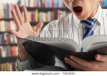 Shocked Businessman Or Professor When Reading Journal