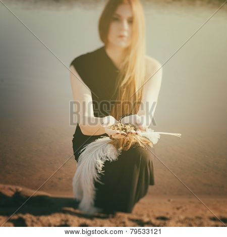 Gothic Girl With Long Red Hair And Ground In Palms