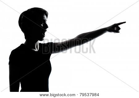 one  young teenager silhouette girl pointing surprised portrait in studio cut out isolated on white background