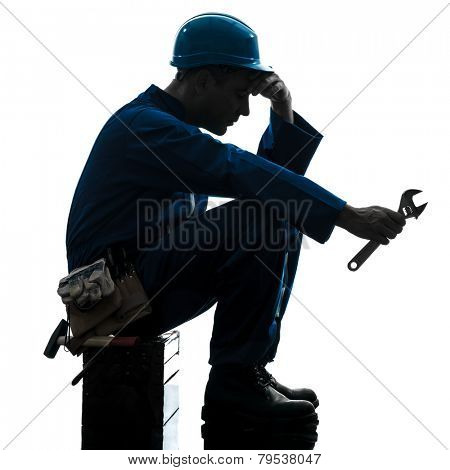 one  repairman worker sad fatigue failure silhouette in studio on white background