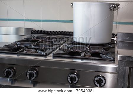 Large Aluminum Pot Over The Stove's Gas Industrial Kitchen