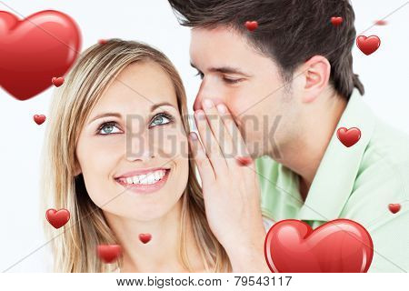 Young man whispering something to his attentive female friend against hearts