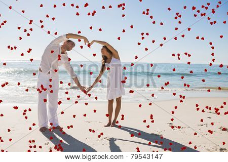 Cute couple forming heart shape with arms against red love hearts