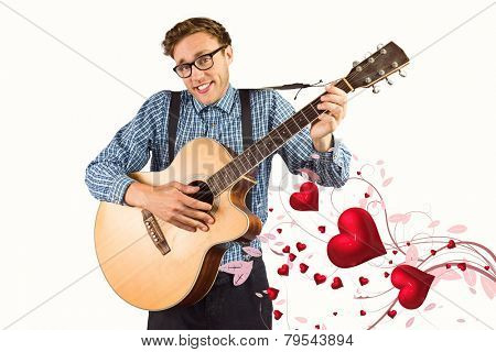 Geeky hipster playing the guitar against valentines heart design