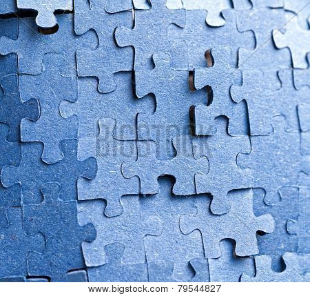 Real Photograph Of The Backside Of Blue Puzzle Jigsaw In Available Light
