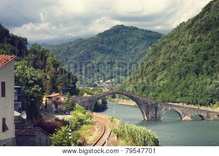 Devil's Bridge Over The River In Italy